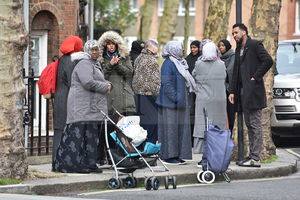 © Licensed to London News Pictures. 08/03/2019. Fulham, London, UK. Members of the public look on as forensics connect a sweep Lnafrey Place where 17yr old Ayub Hassan died of stab wounds sustained in an attack. Four teenagers have been arrested in connection with the murder, the investigation continues. Photo credit: Guilhem Baker/LNP