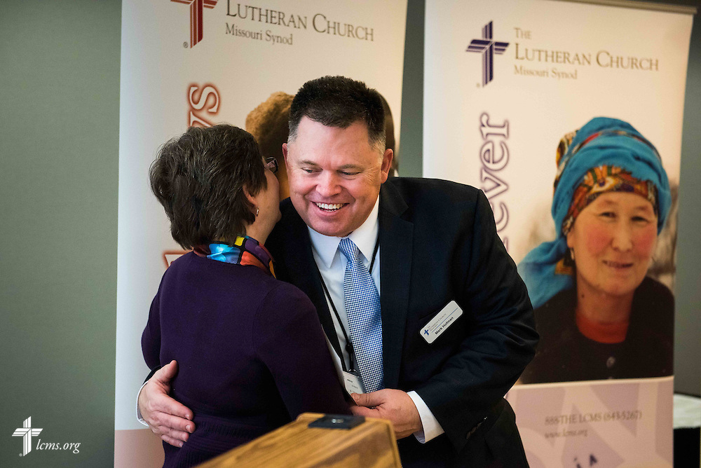 From left, Shelley Moeller, LWML vice-president of Gospel Outreach, presents LCMS Mission Advancement Executive Director Mark Hofman with a check for a grant awarded to the LCMS Global Seminary Initiative, at the LCMS International Center on Wednesday, Jan. 6,  2016 jn Kirkwood, Mo. LCMS Communications/Frank Kohn