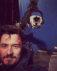 "Orlando Bloom releases a photo on Instagram with the following caption: ""last selfie on a set in my 41st year \ud83c\udf82...i\u2019m grateful and as I contemplate the passage of time I really feel age is just a number and we are not...we ARE the choices we make, the words we speak, the thoughts we create and the actions we take...they shape our realities...and as I say to myself and my son...make smart choices...happy me \u2b55\ufe0fand my loyal companion"". Photo Credit: Instagram *** No USA Distribution *** For Editorial Use Only *** Not to be Published in Books or Photo Books ***  Please note: Fees charged by the agency are for the agency's services only, and do not, nor are they intended to, convey to the user any ownership of Copyright or License in the material. The agency does not claim any ownership including but not limited to Copyright or License in the attached material. By publishing this material you expressly agree to indemnify and to hold the agency and its directors, shareholders and employees harmless from any loss, claims, damages, demands, expenses (including legal fees), or any causes of action or allegation against the agency arising out of or connected in any way with publication of the material."