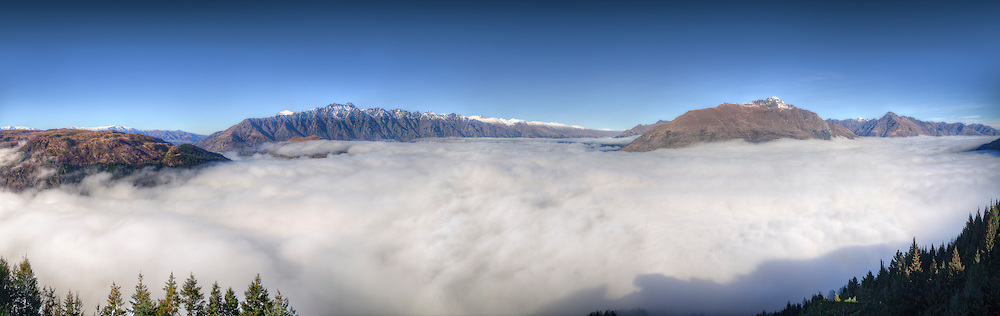 Queenstown looking across cloud to the Remarkables from Walters Peak