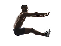 one young african muscular build man long jumping silhouette isolated on white background