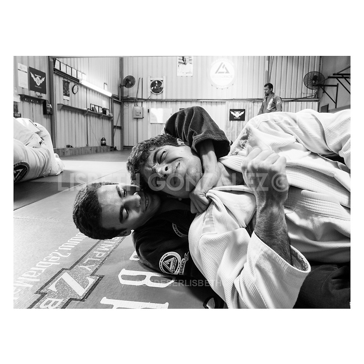 "Choke, Jiu-jitsu apprentices on mid day session tought by master Guillermo ""Gordo"" González, jiu-jitsu black belt and official Tacfit instructor in Rilion Gracie HQ Panama."