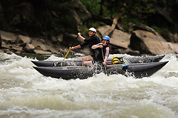 Unidentified rafters run the Fayette Station Rapids on the New River near the New River Gorge Bridge in the New River Gorge National River, West Virginia.