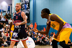 Jordan Nicholls of Bristol Flyers and Jonathan James of London Lions - Photo mandatory by-line: Robbie Stephenson/JMP - 10/04/2019 - BASKETBALL - UEL Sports Dock - London, England - London Lions v Bristol Flyers - British Basketball League Championship