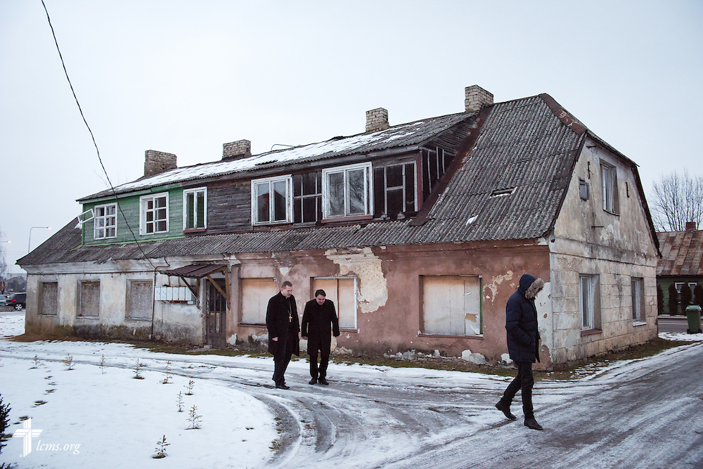 The Rev. Mindaugas Kairys of the Evangelical Lutheran Church in Lithuania walks with Bishop Mindaugas Sabutis (center, left) outside a vacant building planned for renovation into a treatment center for addicts on Friday, Feb. 6, 2015, in Garliava, Lithuania. LCMS Communications/Erik M. Lunsford