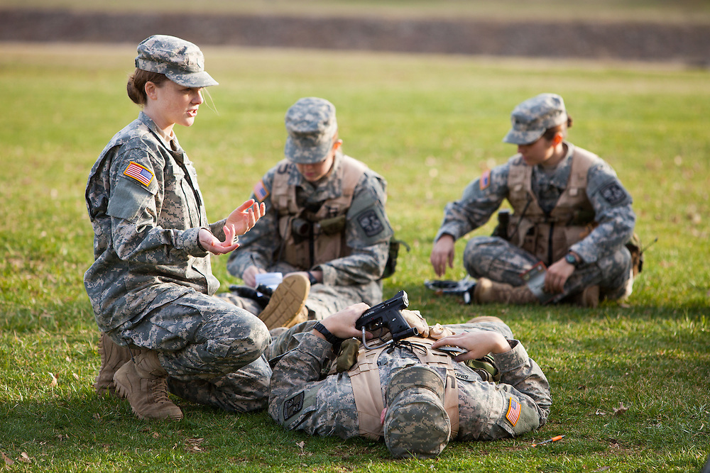 Molly Davis, Battalion Executive officer of Ohio University ROTC Bobcat Battalion demonstrates how to prep a field wound during the training for their weekend combat exercise.  Photo by Ohio University / Jonathan Adams