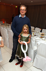 Comedian HARRY ENFIELD and his daughter POPPY at the English National Ballet's Mad Hatters Tea Party at St.Martins Lane Hotel, St Martins Lane, London on 12th December 2006.<br />