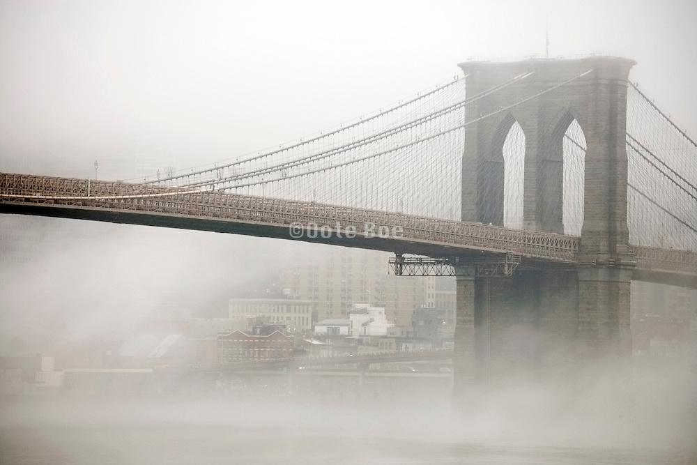 Brooklyn Bridge seen from the Brooklyn side during a morning fog