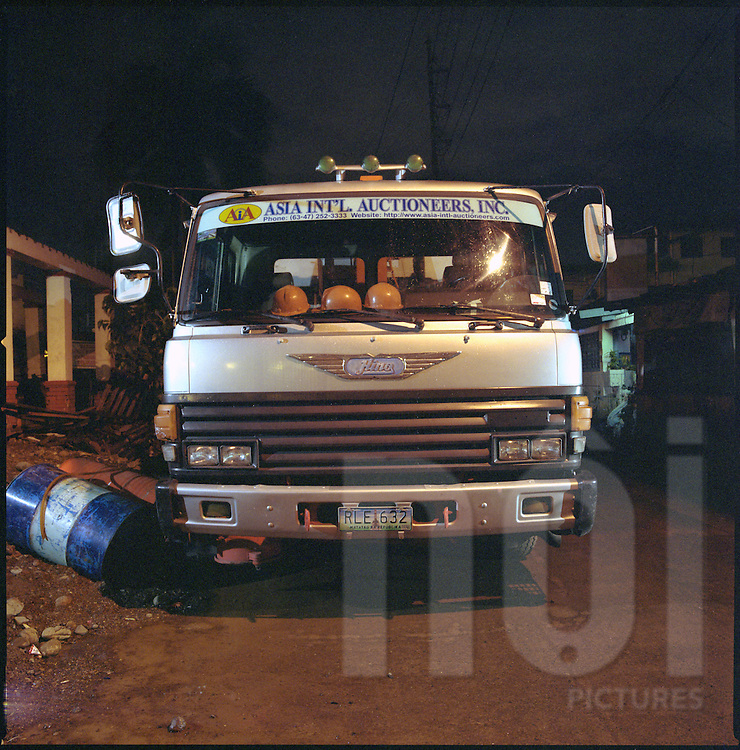 Hino Truck parked for the night in a Manila suburb street, Philippines, Asia