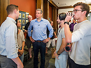 "01 JUNE 2019 - AMES, IOWA: Congressman TIM RYAN (D-OH) talks to college students after a campaign event in Ames Saturday. Ryan declared his candidacy for the US Presidency on the US television show ""The View"" on April 4. Ryan represents Ohio's 13th District, which includes Lordstown, where a large General Motors plant recently closed. Iowa traditionally hosts the the first election event of the presidential election cycle. The Iowa Caucuses will be on Feb. 3, 2020.                PHOTO BY JACK KURTZ"