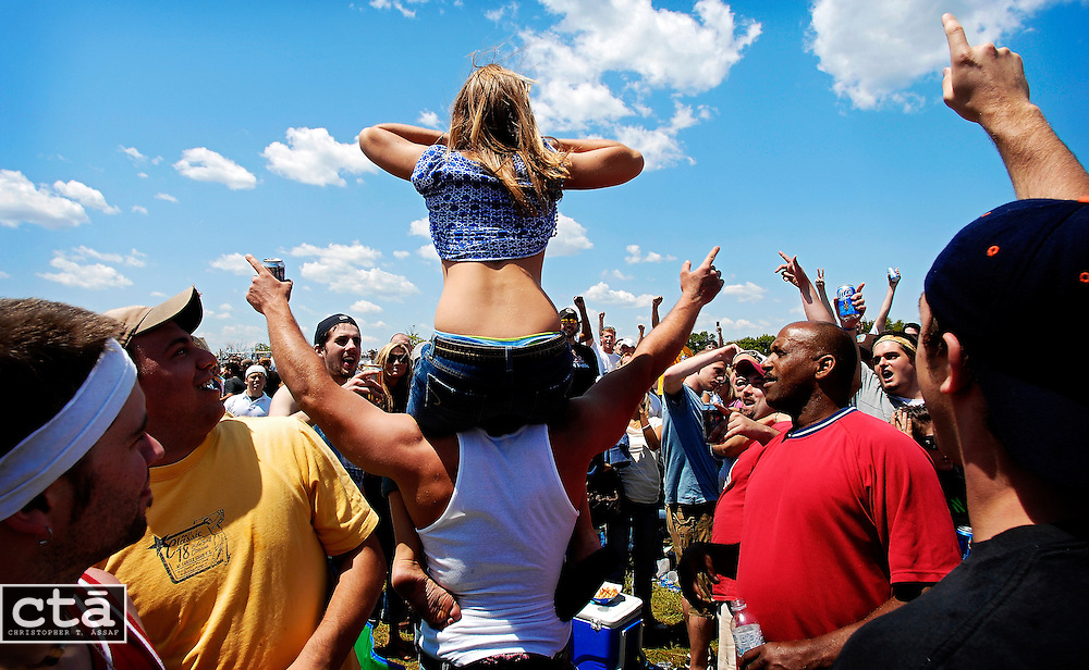 A woman bares herself to the crowd in the rowdy infield of the Preakness Stakes 2007.<br /> <br /> Photo by Christopher T. Assaf/Baltimore Sun staff<br /> <br /> CTA0170