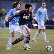 Lee Nguyen, (right), New England Revolution, challenges Mix Diskerud, NYCFC, during the New York City FC v New England Revolution, inaugural MSL football match at Yankee Stadium, The Bronx, New York,  USA. 15th March 2015. Photo Tim Clayton
