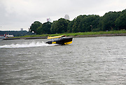 Fast moving DHG water-taxi River Maas near Rotterdam, Netherlands