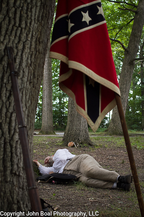 Dave Brown, of Winchester, VA, gets a quick nap in, before educating visitors as a living historian at a Confederate encampment, during the Sesquicentennial Anniversary of the Battle of Gettysburg, Pennsylvania on Wednesday, July 3, 2013.  The Battle of Gettysburg lasted from July 1-3, 1863 resulting in over 50,000 soldiers killed, wounded or missing.  John Boal Photography