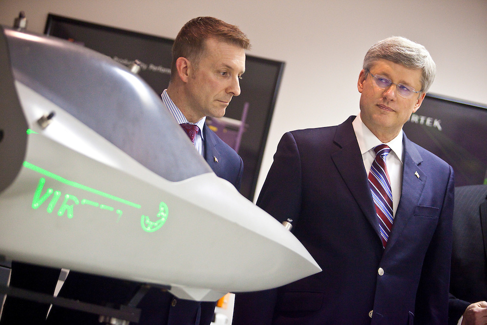 Prime Minister Stephen Harper tours Virtek Vision International, a contractor on the F-35 fighter jet program, in Waterloo Ontario, Friday, March 11, 2011 with Kitchener-Waterloo MP Peter Braid.<br /> THE CANADIAN PRESS/ Geoff Robins