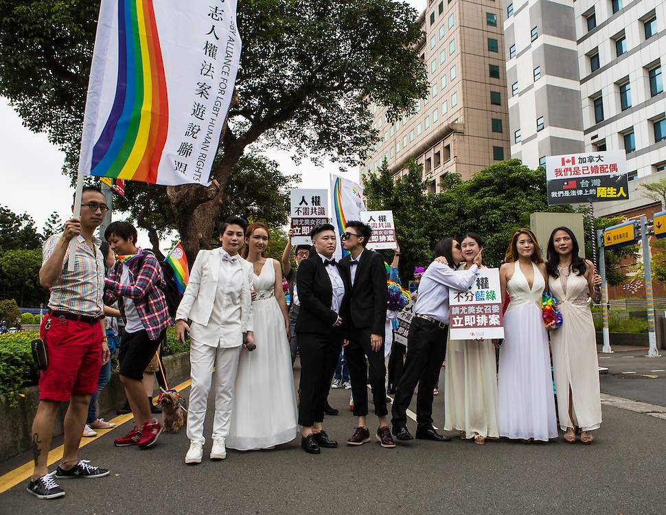 "Campaigning for equal marriage rights at the Pride Parade. The annual march through Taipei's city streets is the largest in Asia, with well over 50 000 people taking part. The 2014 event had the theme ""Walk in Queer's Shoes"", to encourage the wider community to lend their support for equal marriage rights."