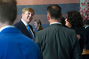 Koning Willem Alexander bij viering eerste lustrum ProDemos  in de Koninklijke Schouwburg . ProDemos heeft als doel mensen te informeren over de Nederlandse democratische rechtsstaat en organiseert activiteiten om de betrokkenheid bij diverse doelgroepen te bevorderen.<br /> <br /> King Willem Alexander attends the celebration of the first anniversary ProDemos in the Royal Theatre. ProDemos aims to inform people about the Dutch democratic constitutional and organizes activities to promote the involvement in various target groups.<br /> <br /> Op de foto / On the photo:  Koning Willem Alexander praat met de genomineerden van de ProDemosprijs / King Willem Alexander talks to the nominees of the ProDemosprijs