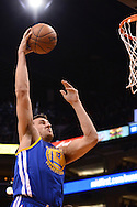 Dec 15, 2013; Phoenix, AZ, USA; Golden State Warriors center Andrew Bogut (12) goes up with the ball against the Phoenix Suns in the first half at US Airways Center. The Suns defeated the Warriors 106-102. Mandatory Credit: Jennifer Stewart-USA TODAY Sports