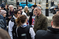 PLACE, January 14 2018. A few dozen protesters from 'The People's Charter' group demonstrate outside Downing Street demanding that the Brexit referendum result is respected following calls for a second referendum. PICTURED: Police speak to one of the protesters after a cyclist who repeatedly rode past the demonstration had the EU flag he was flying stolen from him. © Paul Davey