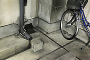 gutter and bicycle inside a parking garage
