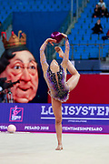 Ashram Linoy during qualifying at ball in Pesaro World Cup at Adriatic Arena on April 13, 2018. Linoy  is an Isrlaelian rhythmic gymnastics athlete born on May 13,1999 in Tel Aviv. Her targhet is to win Israel's first Olympic rhythmic gymnastics medal at the 2020 Olympic Games in Tokyo.
