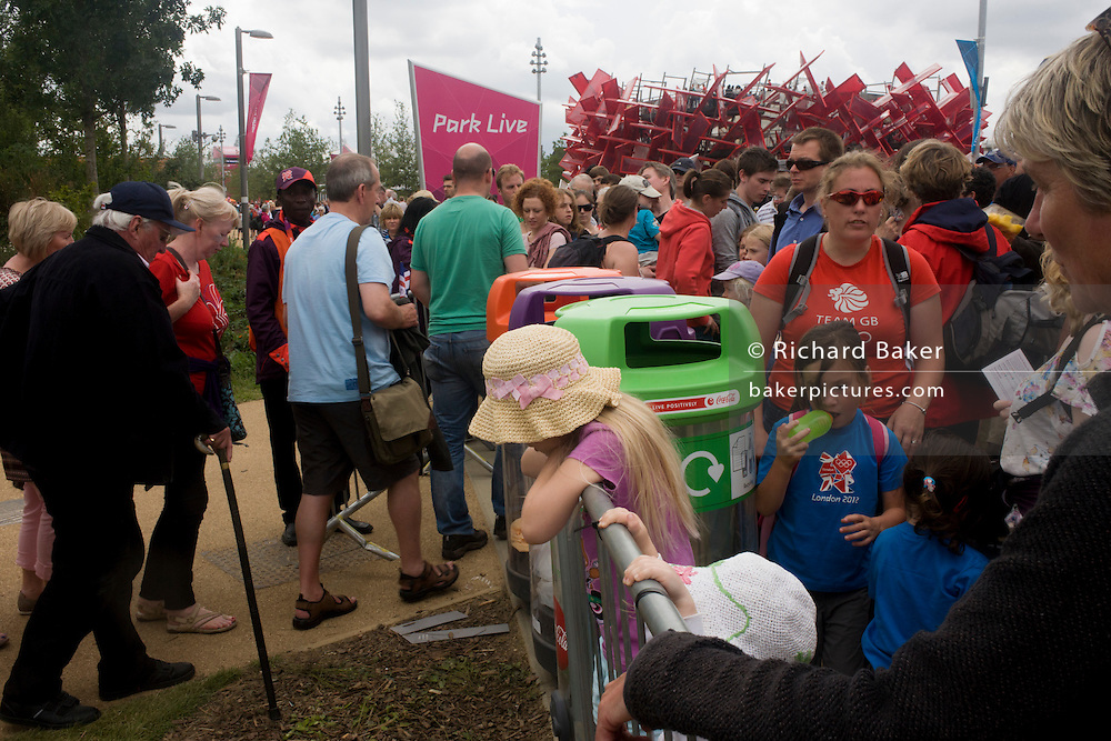 Crowds of spectators in the Olympic Park during the London 2012 Olympics. This land was transformed to become a 2.5 Sq Km sporting complex, once industrial businesses and now the venue of eight venues including the main arena, Aquatics Centre and Velodrome plus the athletes' Olympic Village. After the Olympics, the park is to be known as Queen Elizabeth Olympic Park.