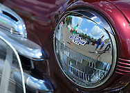 TULLYTOWN, PA - AUGUST 24: Spectators are reflected in a 1937 Chevy headlight at the Tullytown Fire Company's annual car and motorcycle show August 24, 2014 in Tullytown, Pennsylvania. The show is held to raise money to buy firefighting equipment. (Photo by William Thomas Cain/Cain Images)