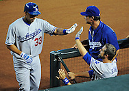 Aug. 6 2011; Phoenix, AZ, USA; Los Angeles Dodgers outfielder Juan Rivera (33) is congratulated by teammate .Casey Blake (23) after scoring during the second inning against the Arizona Diamondbacks at Chase Field.  Mandatory Credit: Jennifer Stewart-US PRESSWIRE..