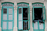 Row of blue windows in Little India in Singapore