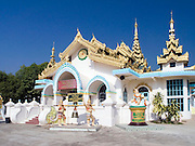 Buddhist temple; Township of Dhammayon; bright white; gold & blue trim; Tachileik; Myanmar