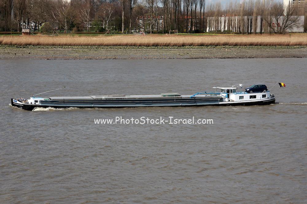 Belgium, Antwerp, a barge on the Scheldt river