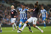 Derby County defender Cyrus Christie (2) and Brighton central midfielder, Beram Kayal (7) during the Sky Bet Championship match between Brighton and Hove Albion and Derby County at the American Express Community Stadium, Brighton and Hove, England on 2 May 2016.