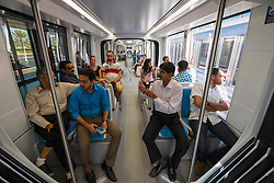Interior of carriage of tram with passengers on new Dubai Tram system in Marina district of Dubai United Arab Emirates
