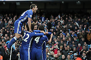 Chelsea's Cesar Azpilicueta rises the highest as the Chelsea plays celebrate with Chelsea's Eden Hazard after he scores the fourth goal of the game to make the score 3-1 during the Premier League match between Manchester City and Chelsea at the Etihad Stadium, Manchester, England on 3 December 2016. Photo by Simon Brady.