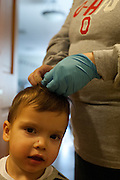 Max Beymer has toothpaste removed from his hair by his teahcer Dana Parsely at the Ohio Univeristy Childhood development Center. © Ohio University / Photo by Ross Brinkerhoff