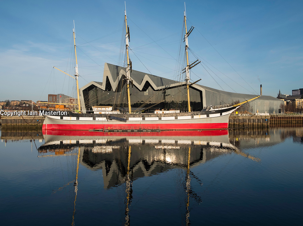 View of Riverside Museum beside River Clyde home of Glasgow Transport Museum with Glenlee ship moored in front in Glasgow, United Kingdom