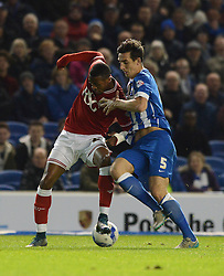 Jonathan Kodjia of Bristol City challenges for the ball with Lewis Dunk of Brighton & Hove Albion - Mandatory byline: Dougie Allward/JMP - 07966 386802 - 20/10/2015 - FOOTBALL - American Express Community Stadium - Brighton, England - Brighton v Bristol City - Sky Bet Championship