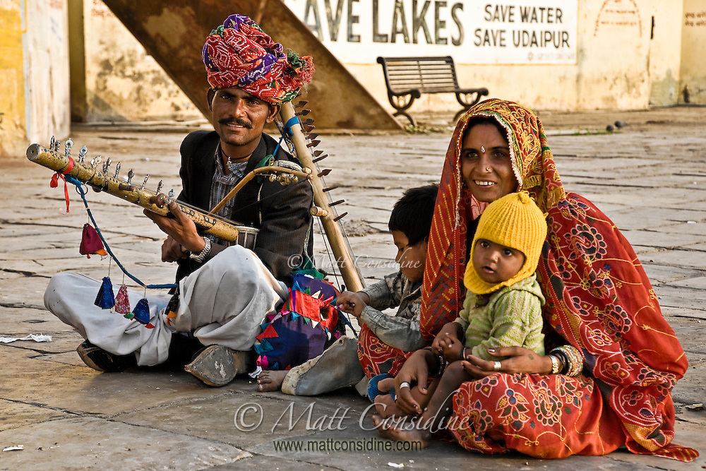 Musician singing and playing folk music on Ravanahatha (a stringed musical instrument) to earn his livelihood.<br /> (Photo by Matt Considine - Images of Asia Collection)