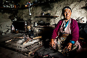 80 year old Tshring Zhang Mo is a Tamang woman, pictured in her home in Langtang Village, Langtang Valley, Nepal, 27th May 2009<br /> <br /> According to Dorothea Stumm, a glaciologist at the Nepal-based International Centre for Integrated Mountain Development, a massive hanging glacier cracked when an earthquake struck at 11.56am on the 25th April 2015. The ice formed a cloud that gathered snow and rocks and then funnelled down the mountain, burying the village, and creating an enormous pressurised blast. 400 residents of the village and up to 100 trekkers are believed to have been killed.<br /> <br /> PHOTOGRAPH BY AND COPYRIGHT OF SIMON DE TREY-WHITE<br /> <br /> + 91 98103 99809<br /> email: simon@simondetreywhite.com<br /> photographer in delhi