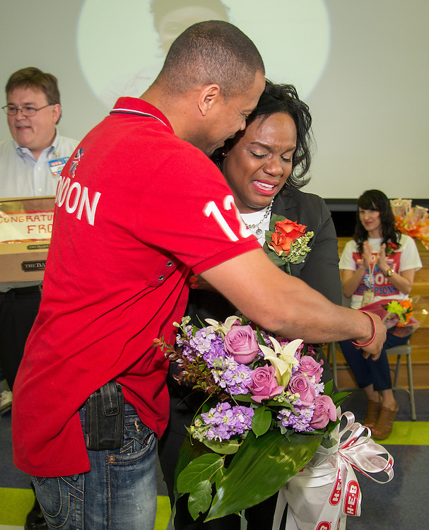 Lockhart Elementary School principal Felicia Adams is hugged by her husband Ray Adams after being named a finalist in the HEB Excellence in Education Awards, April 4, 2014.