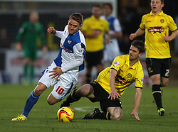 Bristol Rovers' Eliot Richards is tackled by Burton Albion's Shane Cansdell-Sherriff-- Photo mandatory by-line: Matt Bunn/JMP - Tel: Mobile: 07966 386802 23/11/2013 - SPORT - Football - Burton - Pirelli Stadium - Burton Albion v Bristol Rovers - Sky Bet League Two