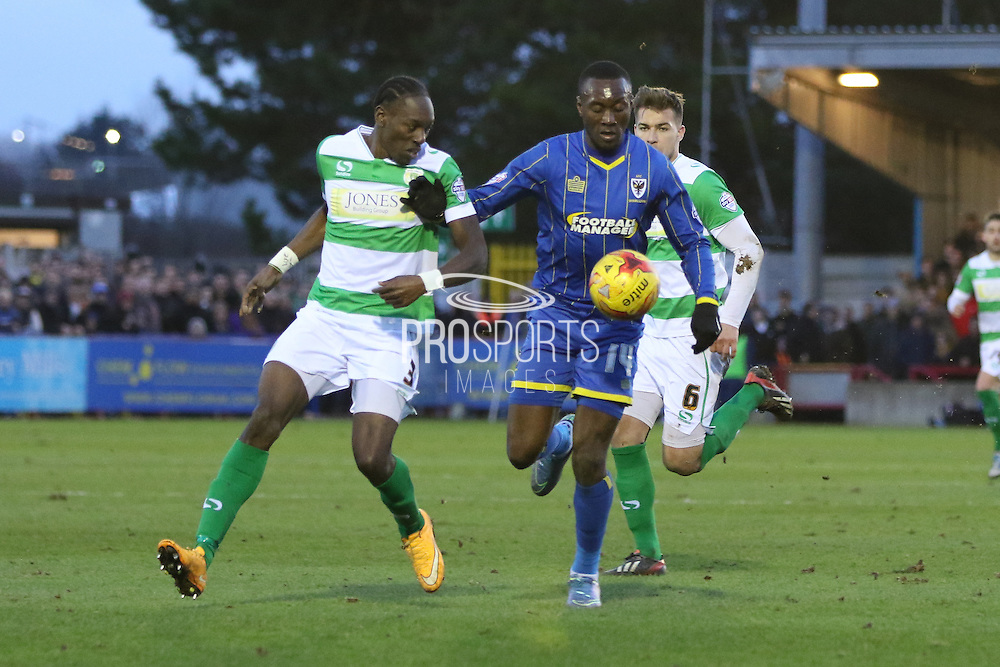 Ade Azeez of AFC Wimbledon surges forward during the Sky Bet League 2 match between AFC Wimbledon and Yeovil Town at the Cherry Red Records Stadium, Kingston, England on 30 January 2016. Photo by Stuart Butcher.