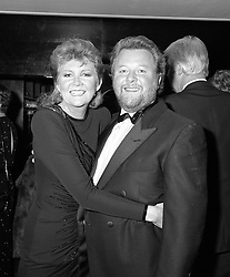 CILLA BLACK and her late husband BOBBY WILLIS at a Ball in London on 3/12/1986