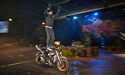 © licensed to London News Pictures. London, UK 02/01/12. Stunts, jumps and unique motorbike tricks are being performed by professional riders at the Revolution Show as The Carole Nash MCN Motorcycle Show 2012 takes place at ExCeL, London from 2nd-5th Feb 2012. Photo credit: Tolga Akmen/LNP