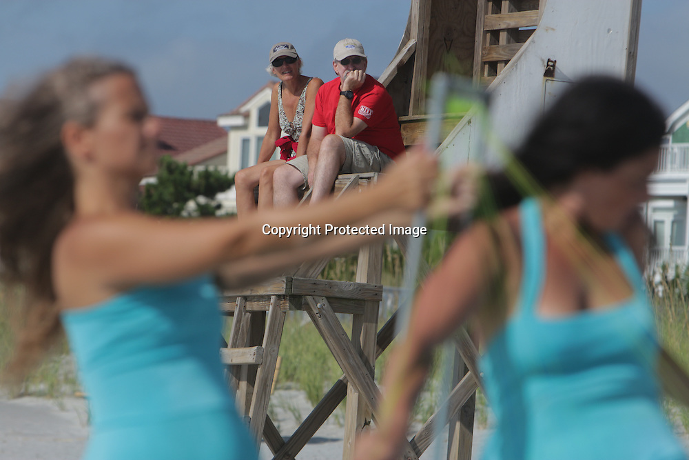 Artists performed for beach-goers during the SARUS Festival Sunday August 24, 2014 at Wrightsville Beach, N.C. (Jason A. Frizzelle)