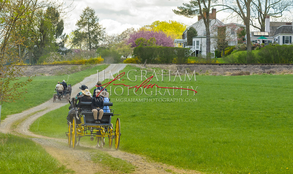 Carriages head up a path at Point Lookout Farm to lunch during the second of three drives from The Big Bend Farm in Chadds Ford, Pa., Saturday 2 May 2015. Photography by Jim Graham