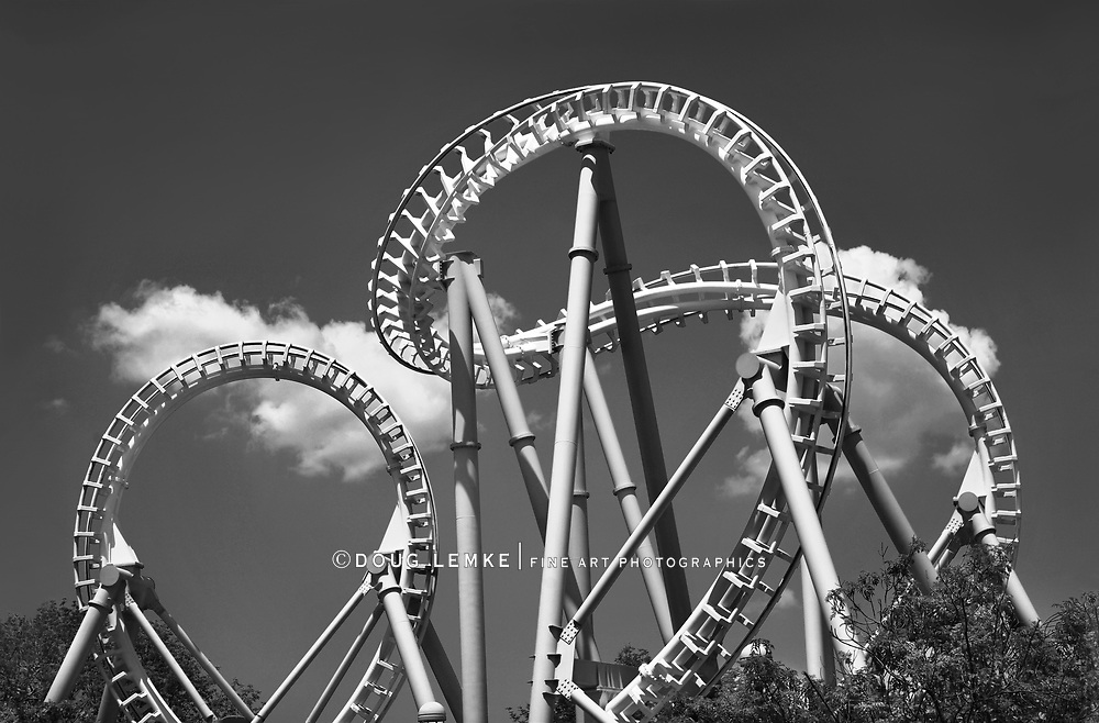 A Looping Roller Coaster On A Beautiful Sunny Day