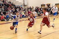 Gilford's Korey Weston dribbles down court past Lou Athanas Laconia's Ethan Sirles during the senior boys action at the annual Francoeur/Babcock Basketball Tournament Friday evening.  (Karen Bobotas/for the Laconia Daily Sun)