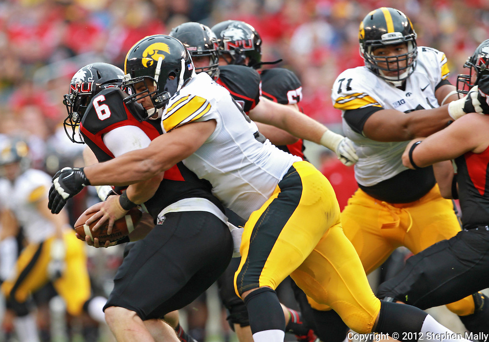 September 01 2012: Iowa Hawkeyes defensive lineman Joe Gaglione (99) tries to swat the ball away from Northern Illinois Huskies quarterback Jordan Lynch (6) during the second half of the NCAA football game between the Iowa Hawkeyes and the Northern Illinois Huskies at Soldiers Field in Chicago, Illinois on Saturday September 1, 2012. Lynch fumbled on the ball and Iowa defeated Northern Illinois 18-17.