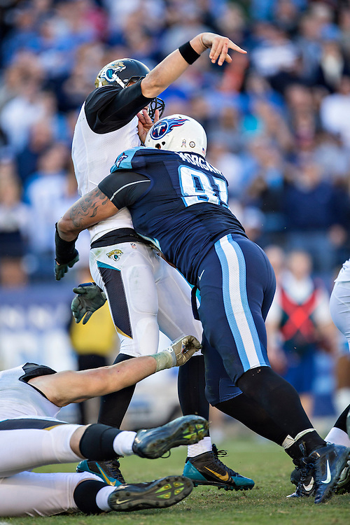 NASHVILLE, TN - NOVEMBER 10:  Chad Henne #7 of the Jacksonville Jaguars is hit by Derrick Morgan #91 of the Tennessee Titans at LP Field while throwing a pass on November 10, 2013 in Nashville, Tennessee.  The Jaguars defeated the Titans 29-27.  (Photo by Wesley Hitt/Getty Images) *** Local Caption *** Chad Henne; Derrick Morgan